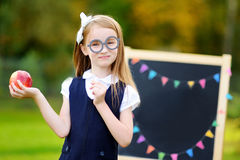 Cute little schoolgirl feeling excited about going back to school. Cute little schoolgirl feeling very excited about going back to school Royalty Free Stock Photo