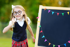 Cute little schoolgirl feeling excited about going back to school. Cute little schoolgirl feeling very excited about going back to school Royalty Free Stock Photos