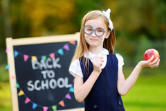 Cute little schoolgirl feeling excited about going back to school. Cute little schoolgirl feeling very excited about going back to school Stock Photography