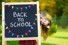 Cute little schoolgirl feeling excited about going back to school. Cute little schoolgirl feeling very excited about going back to school Stock Photos