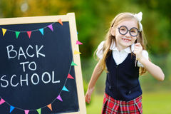Cute little schoolgirl feeling excited about going back to school. Cute little schoolgirl feeling very excited about going back to school Royalty Free Stock Image