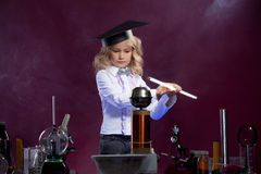 Cute little scientist posing in physics laboratory Stock Images