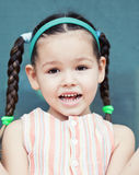 Cute little аsian  girl with pigtails Stock Images