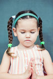 Cute little аsian girl is praying Royalty Free Stock Images