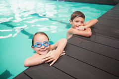 Cute little siblings smiling in the pool Stock Photo