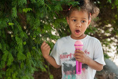 Cute little singer girl singing on the microphone in the city pa Stock Images