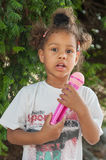 Cute little singer girl singing on the microphone in the city pa Stock Photos