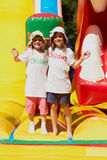 Cute little sisters in a jumping castle Royalty Free Stock Photo