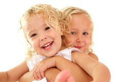 Cute little sisters together. Close up portrait of cute little sisters together royalty free stock photography