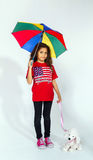 Cute little smiling afro-american girl with umbrella and toy Stock Photo