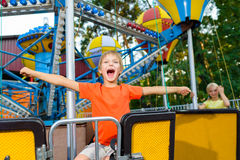 Cute little smiling boy riding a Carnival Carousel Stock Photography