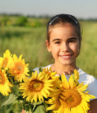 Cute little smiling child with sunflowers Royalty Free Stock Images