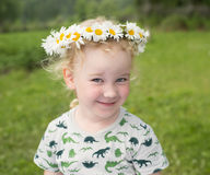 Cute little smiling girl in the chamomile wreath Royalty Free Stock Image