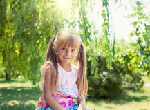 Little girl in the park. Cute little smiling girl in the park royalty free stock photos