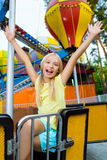 Cute little smiling girl riding a Carnival Stock Photos