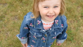 Cute little smiling girl stock footage
