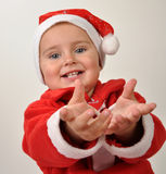 Cute little smiling Santa toddler girl Stock Photos