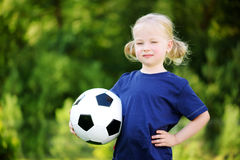 Cute little soccer player having fun playing a soccer game on summer day Royalty Free Stock Photos