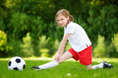 Cute little soccer player having fun playing a soccer game on summer day Stock Images