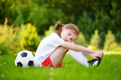 Cute little soccer player having fun playing a soccer game on summer day Royalty Free Stock Image