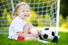 Cute little soccer player having fun playing a soccer game Stock Photos