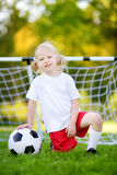Cute little soccer player having fun playing a soccer game Stock Photo