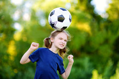 Cute little soccer player having fun playing a soccer game Royalty Free Stock Image