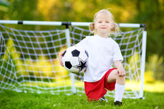 Cute little soccer player having fun playing a soccer game Stock Images