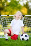 Cute little soccer player having fun playing a soccer game Royalty Free Stock Photo