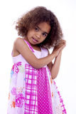 Cute Little South African Poser. Little girl with pink dress looking at camera with a fashion pose Stock Photo