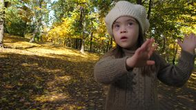 Adorable girl with down syndrome dancing in nature stock footage