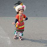 Cute little Taiwanese girl in garb of Hualien Tribe with headdress and skirt, Kaohsiung, Taiwan. Little girl - five years old - from dancing group in colorful stock photo