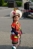 Cute little Taiwanese girl in garb of Hualien Tribe with headdress and skirt, Kaohsiung, Taiwan. Little girl - 5 years old - from dancing group in colorful garb stock image