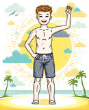 Cute little teen boy standing in colorful stylish beach shorts. Stock Images