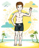 Cute little teen boy standing in colorful stylish beach shorts. Royalty Free Stock Image