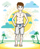 Cute little teen boy standing wearing fashionable beach shorts. Stock Photography