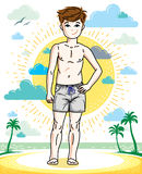 Cute little teen boy standing wearing fashionable beach shorts. Stock Images