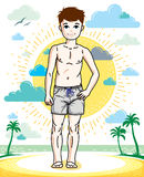 Cute little teen boy standing wearing fashionable beach shorts. Stock Photos