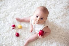 Cute little toddler baby boy, playing with colorful easter eggs Stock Image
