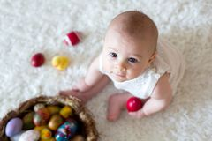 Cute little toddler baby boy, playing with colorful easter eggs Stock Images