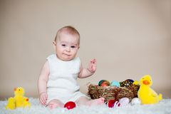 Cute little toddler baby boy, playing with colorful easter eggs Royalty Free Stock Photos