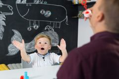 Cute little toddler boy at child therapy session. Royalty Free Stock Images