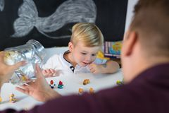 Cute little toddler boy at child therapy session. Royalty Free Stock Image