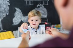 Cute little toddler boy at child therapy session. Cute little playfull toddler boy at child therapy session. Private one on one homeschooling with didactic aids Stock Photography