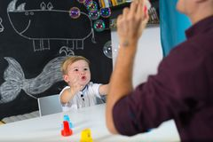 Cute little toddler boy at child therapy session. Stock Image