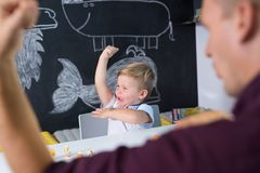 Cute little toddler boy at child therapy session. Stock Photos