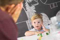 Cute little toddler boy at child therapy session. Stock Photo