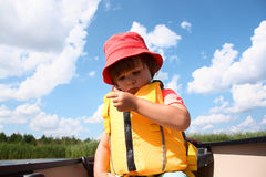 Cute little toddler boy sitting in canoe in the lake Stock Image