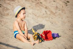 Happy boy playing on the beach royalty free stock images