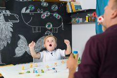 Cute little toddler boy at speechtherapist session. Royalty Free Stock Image
